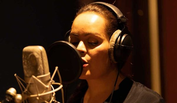 Female voice-over artist behind the mic