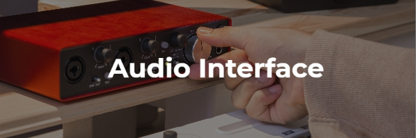 Hand plugs in mic to audio interface