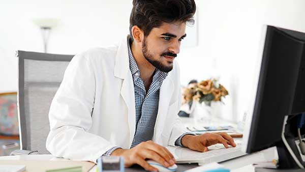 A young Doctor watching a business promo