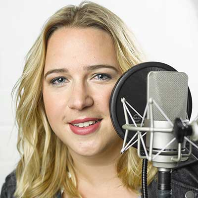 German Voice Actor Henrike pictured with Microphone