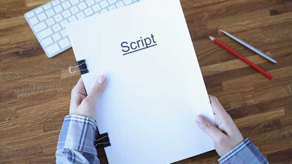 Writer holding finished script