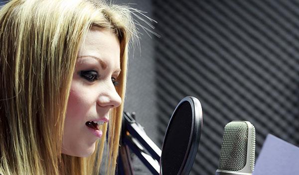 Female narrator recording audiobook